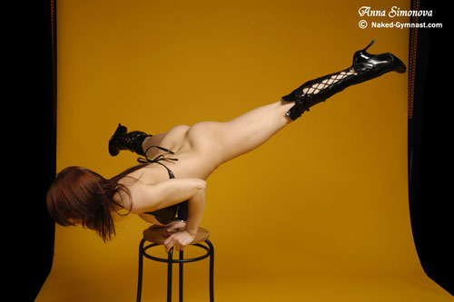 Fetish nude acrobatics balancing on a stool