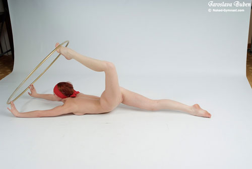 Nude yoga half bow pose with a hoop