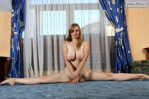 Busty naked gymnast girl in the straddle split